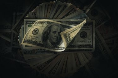 dollar banknotes on dark