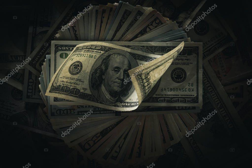 dollar banknotes on dark