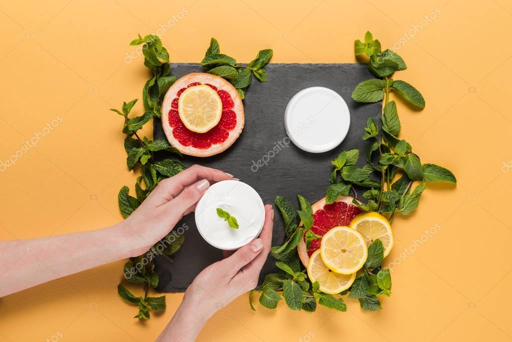 hands with citrus cream