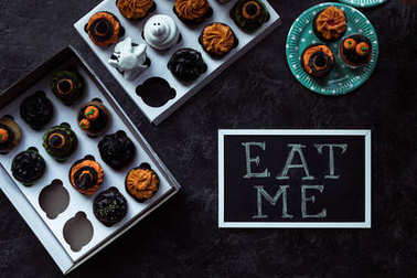Halloween cupcakes and eat me inscription