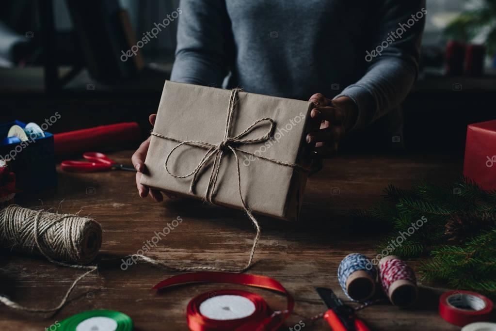 woman showing christmas gift