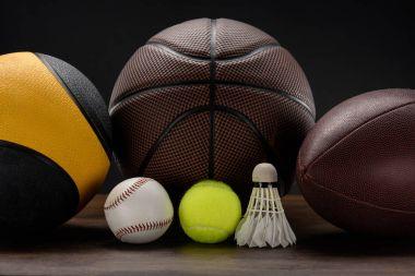 various sports balls and shuttlecock