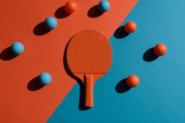 ping pong racket and balls