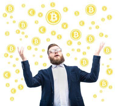 Businessman with bitcoin symbols
