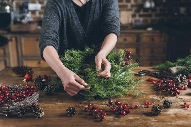 decorator making Christmas wreath