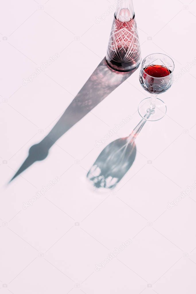 Glass and carafe with wine