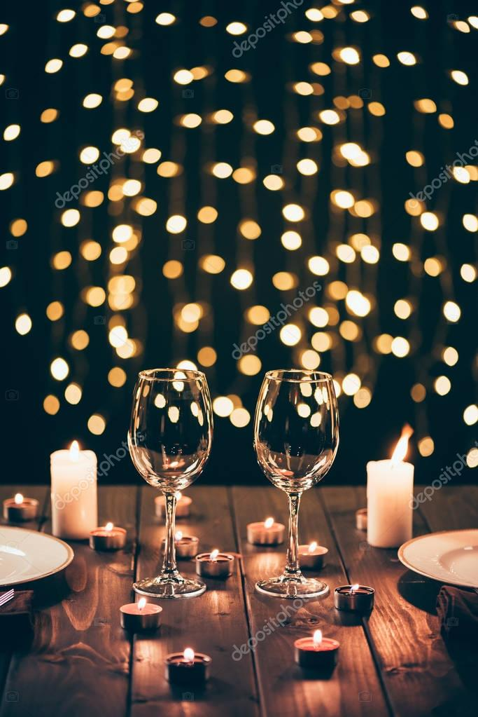 wineglasses on table with candles