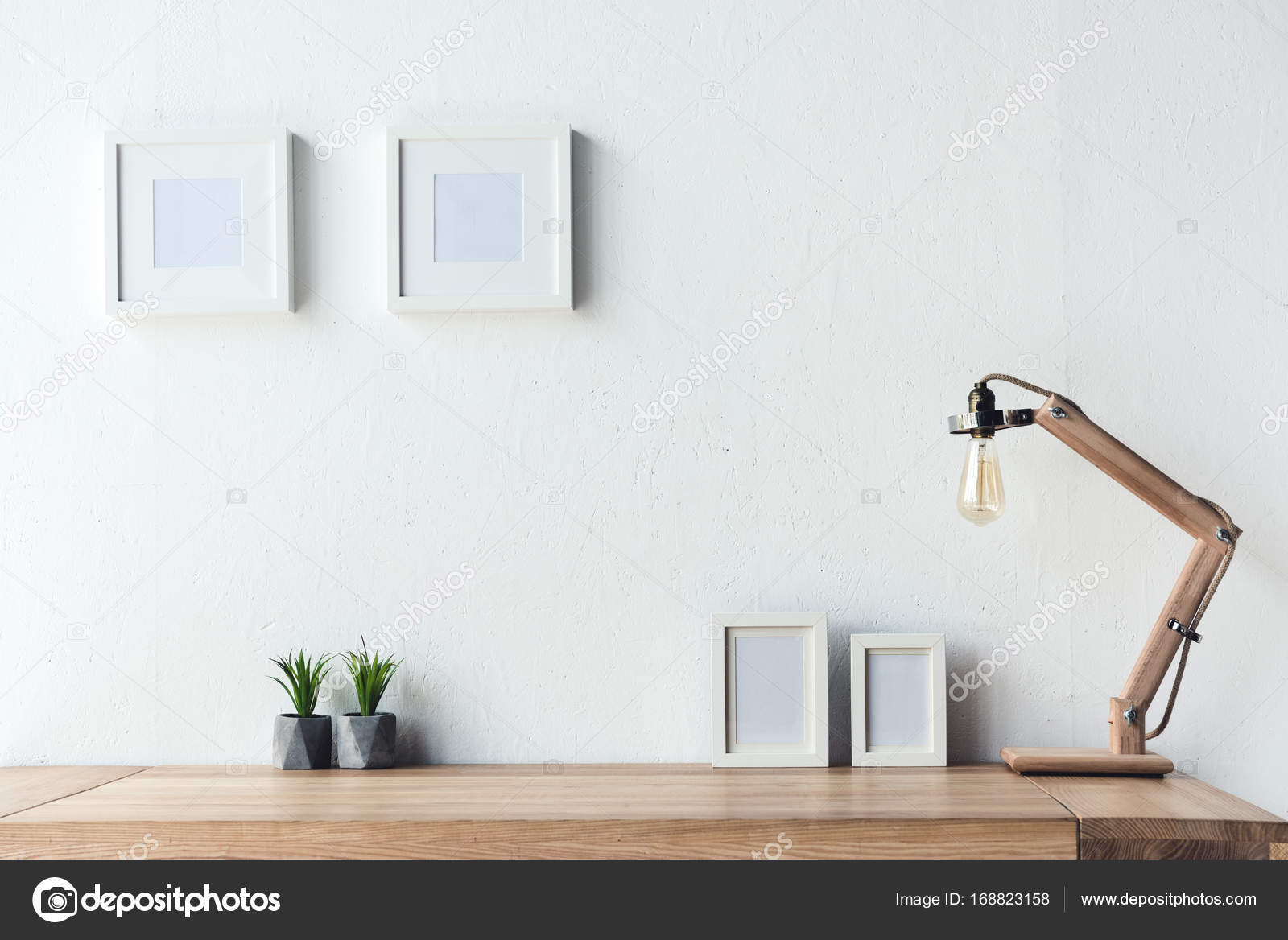 photo frames hanging on wall at workplace — Stock Photo ...
