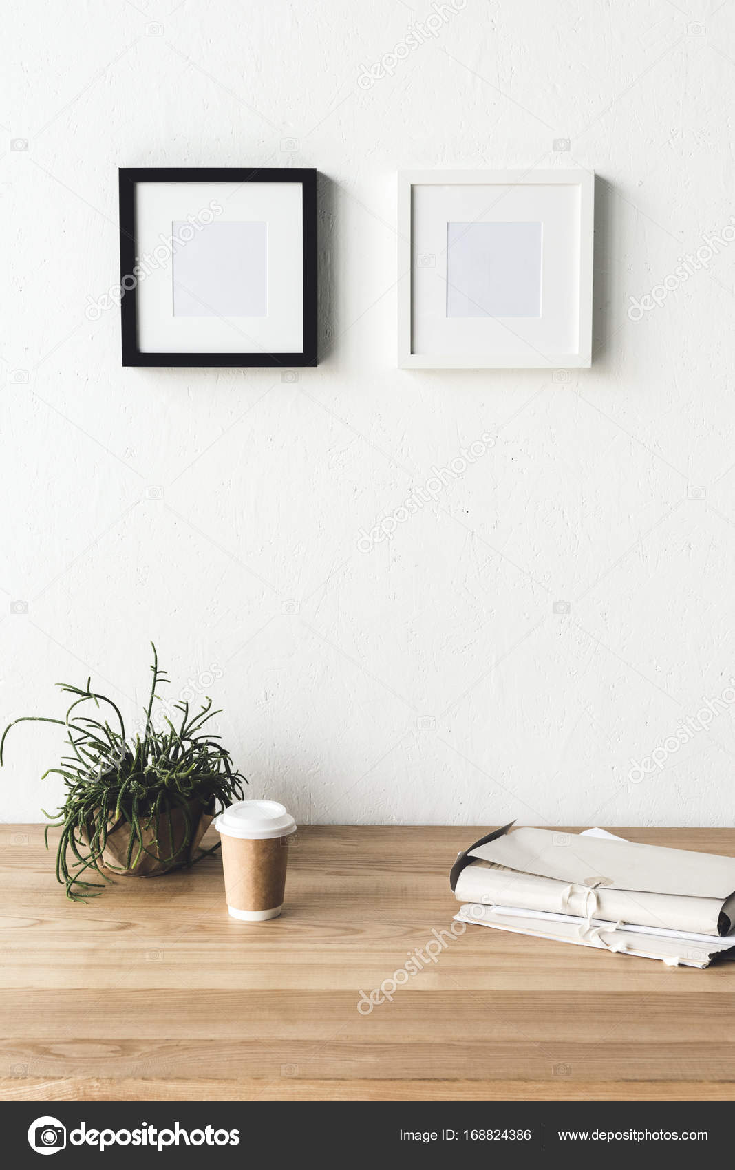 photo frames hanging on wall in room — Stock Photo © VadimVasenin ...