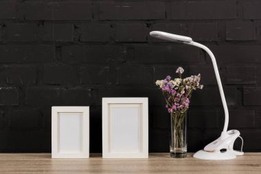 empty photo frames and table lamp