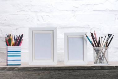 photo frames and office supplies at workplace