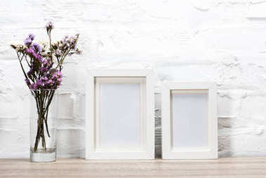 photo frames and flowers in vase
