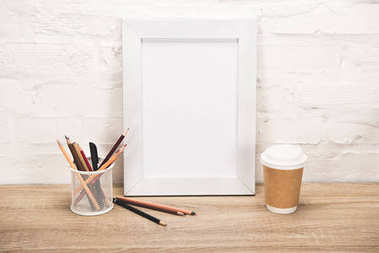 Photo frame and coffee to go on table