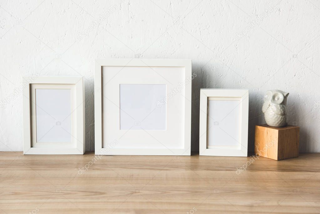 empty photo frames on table