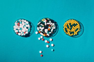 colorful pills in petri dishes