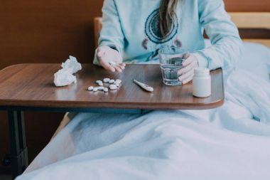 sick person taking medicine