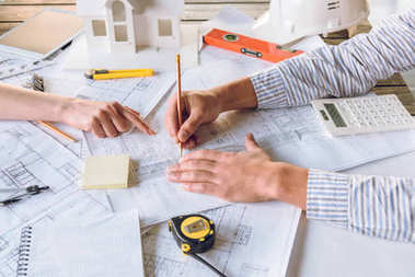 Cropped shot of architects working on new plan together stock vector