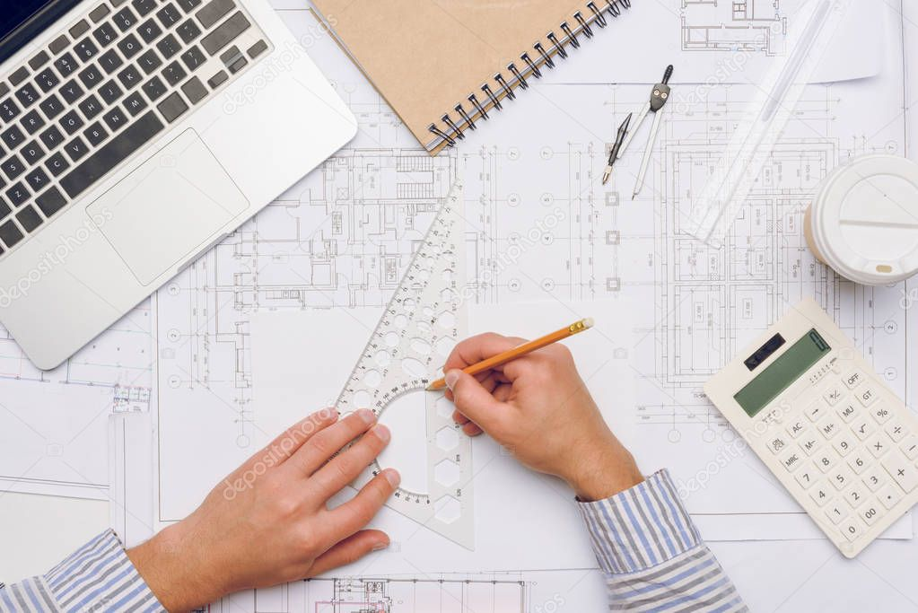 architect working with blueprints