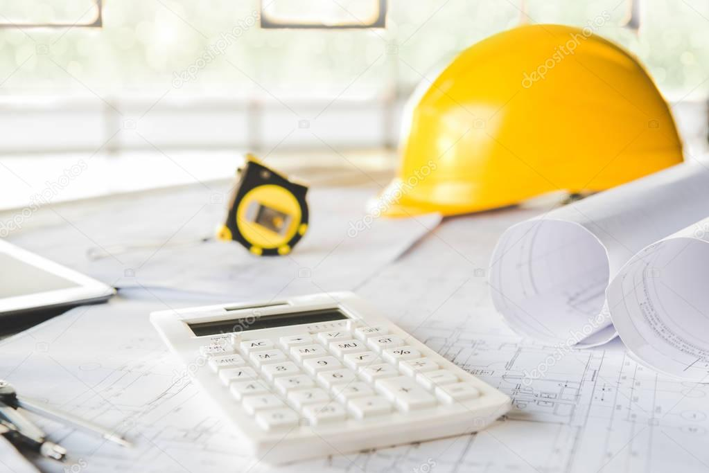 calculator and architectural blueprints