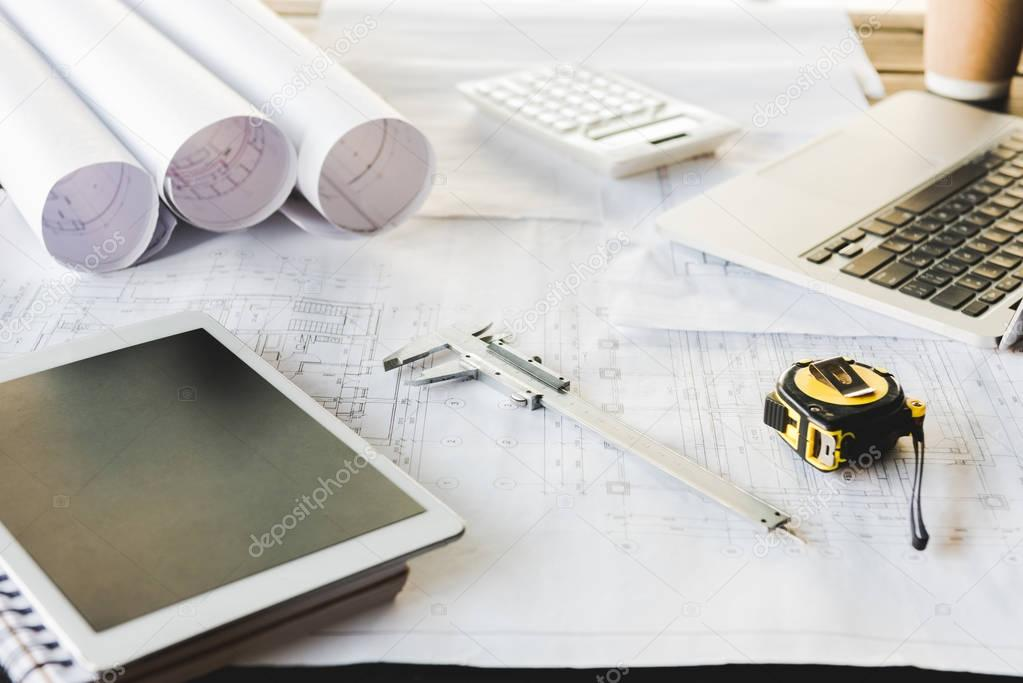 tablet and architectural blueprints