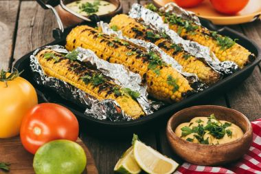 grilled corn covered in foil