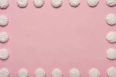 Frame made of white marshmallows, isolated on pink stock vector