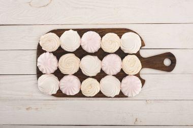 marshmallows on wooden board