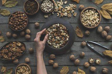 assorted nuts and autumn leaves
