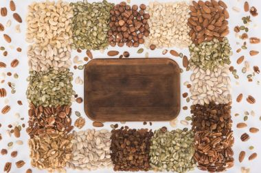 assorted nuts and wooden board