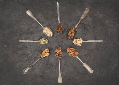 assorted nuts in spoons