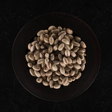 delicious pistachios on plate