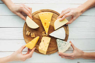 hands holding cheese