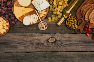 various types of cheese and bottle of wine