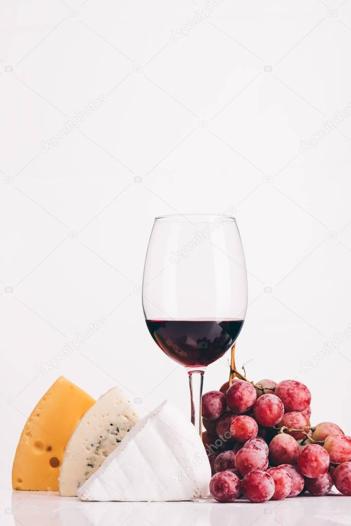 cheese, glass of red wine and grapes