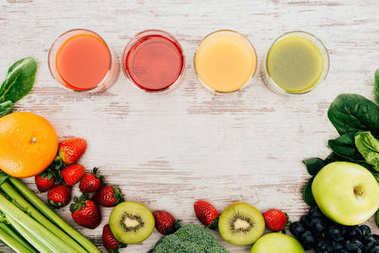 glasses of juice and healthy food