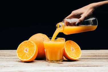 woman pouring fresh juice into glass