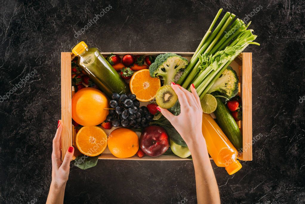 woman holding box with healthy food