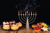 Photo traditional jewish menorah and sweets