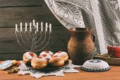 Photo traditional jewish menorah, Kippah and donuts
