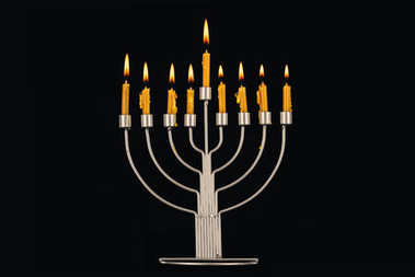 Hanukkah celebration with menorah and candles, isolated on black stock vector