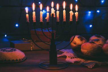 Traditional jewish menorah, Kippah, presents and donuts for hanukkah celebration stock vector