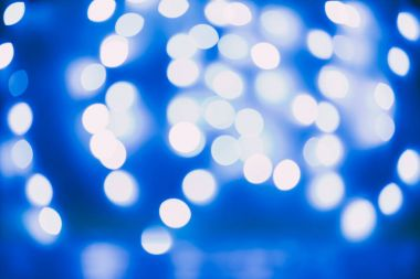 Background with unfocused bokeh blue lights stock vector