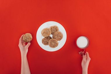hands with cookies and milk