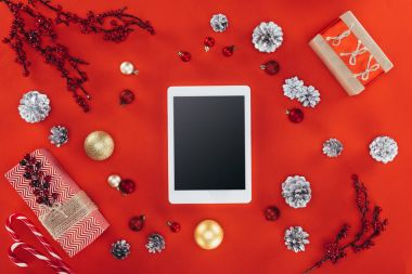 tablet with christmas decor and presents