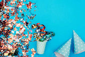 confetti with paper cup and party hats