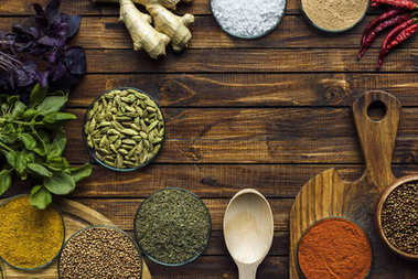 various spices on wooden surface