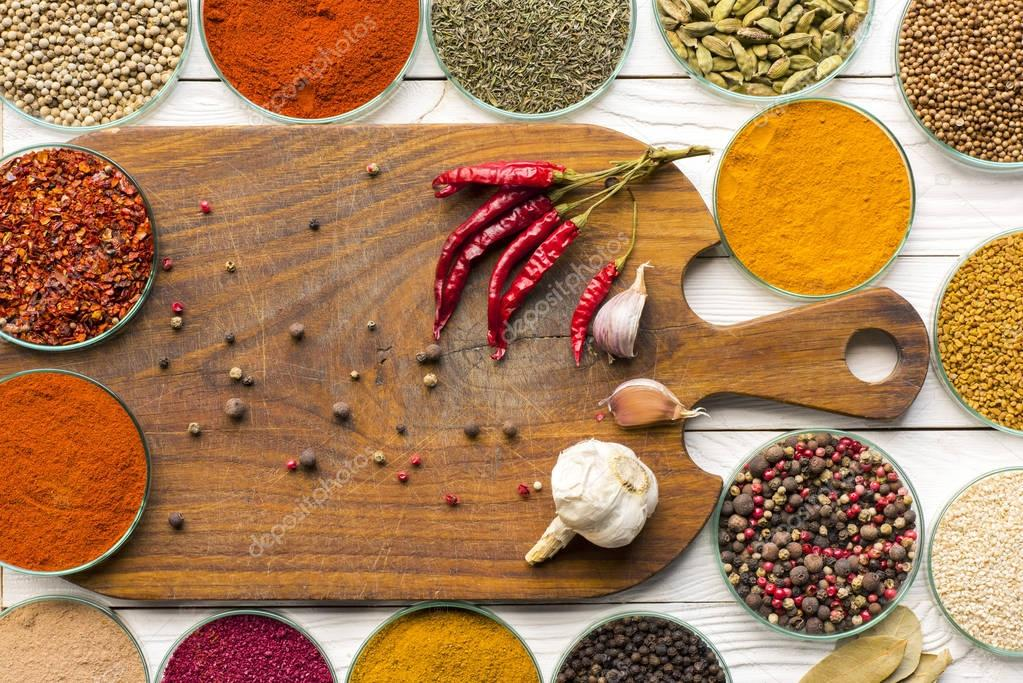 wooden board and colorful spices