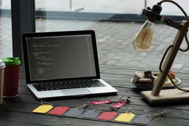 laptop with HTML code