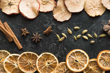 dried apples and oranges with cinnamon sticks