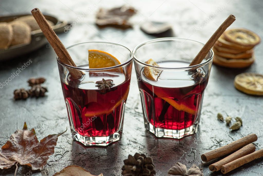 glasses of mulled wine with cinnamon sticks